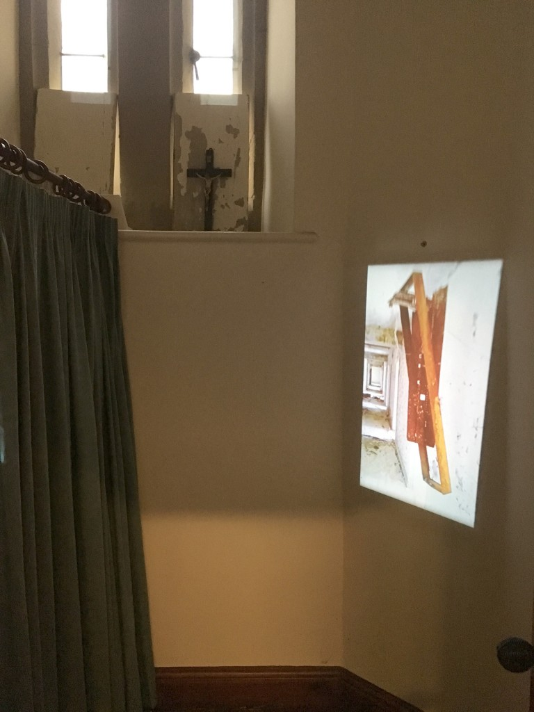 Video installation in the confessional by Melanie Shee